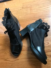 Pair of black leather peep-toe heeled sandals North Vancouver, V7R 2L3
