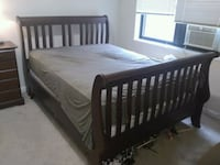 brown wooden bed frame with white mattress Bethesda, 20814