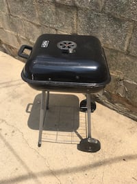 Small grill with half of bag of Charcoal Baltimore, 21213