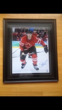 autographed Canadian hockey player poster with brown frame