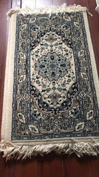 Machine made Persian mat/ area rug; 33 by 20. $25 for one or $40 for two