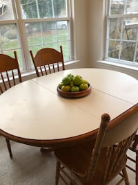 Round brown wooden table with four chairs dining set 203 mi