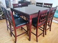 rectangular brown wooden table with 8 chairs di La Prairie, J5R 5M6