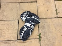 Pair of white-and-black nike bauer goalie gloves