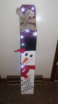 white and red snowboard with bindings Marysville