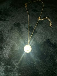 gold-colored necklace with round pendant SeaTac, 98188