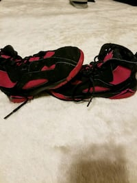pair of red-and-black Nike basketball shoes El Paso, 79936