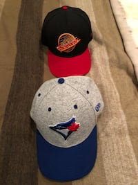 New era Canucks and blue jays hats