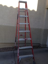 red and gray steel folding ladder