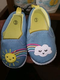 pair of blue and yellow Hello Kitty slip on shoes Las Vegas, 89109