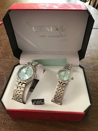 two round silver-colored Geneva analog watches with link bands and box Bellefontaine, 43311
