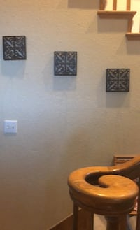 3 piece black metal wall accent with candle holder