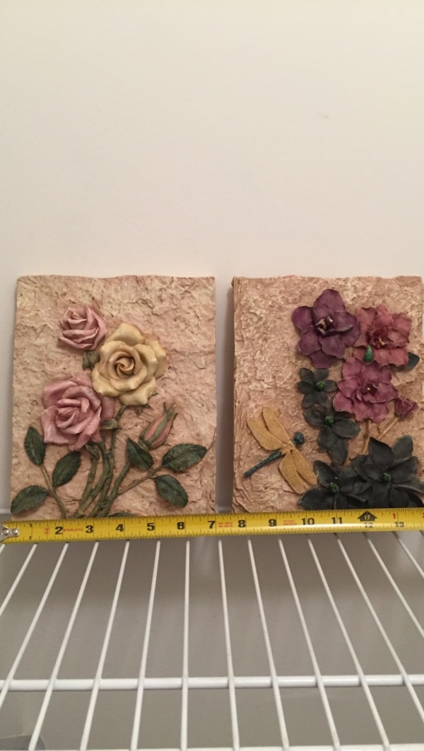 Two Brown Tablet With Pink Yellow And Purple Flowers Table Decor