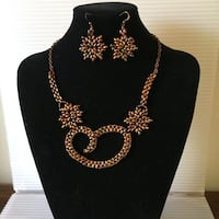 gold-colored flower necklace