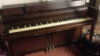 Brown wooden upright piano 41 km