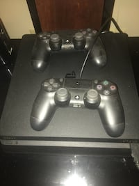 black Sony PS4 console with two controllers Lake Milton, 44429