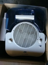 blue and white portable air cooler 61 km