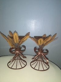 two brown metal frame candle holders