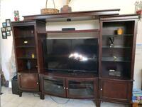 Wood entertainment center TV stand like new North Las Vegas, 89031