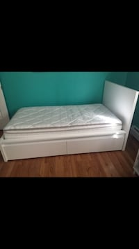 White IKEA twin bed frame and sleep number mattress