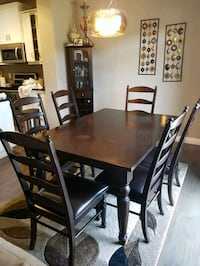 rectangular brown wooden table with six chairs dining set Airdrie, T4B 0B2