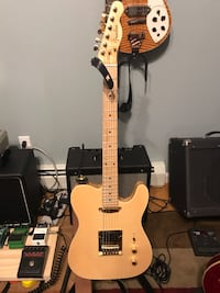brown and white electric guitar Port Jervis, 10940