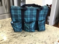 Brand new, in original bag, large utility tote from Thirty One, 7 pockets on outside including 2 mesh pockets on the sides, zipper closure Brampton, L6R