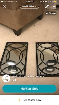 two wall mirrors with black frames and candle holders screenshot London, N5X 2W8