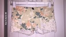 green, yellow, and white floral short shorts
