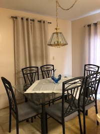 Iron dinette table with glass top and 6 chairs