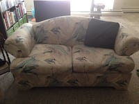 white and blue fabric love seat