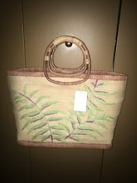 "New Straw handbag by indeed has a snap closure and fully lined size 17 1/2"" wide at the top 15""wide at the bottom 11""high the handles measure another 6"" high Oakville, L6K 1Y8"