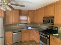 42 inch maple cabinets and appliances set.all as is.