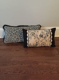 Two black and white floral throw pillows