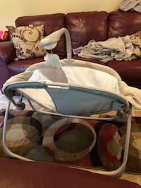 baby's white and gray rocker with music, color changing lights, you can't change the volume to low medium or loud. Does not rock on its own you have to rocket for the baby. Woodbridge, 22192