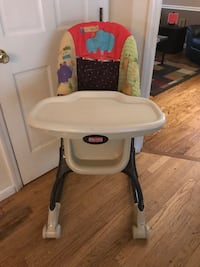 Fisher price zoo print adjustable baby high chair.