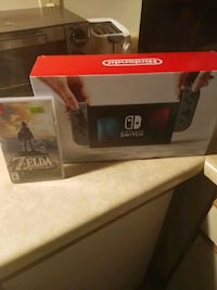 New in box nintendo switch with zelda included New Westminster, V3L 5L7