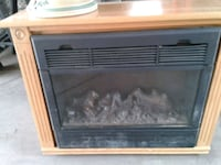 brown wooden framed electric fireplace Chicago, 60641