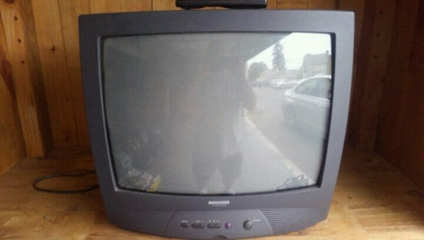 black CRT TV with remote
