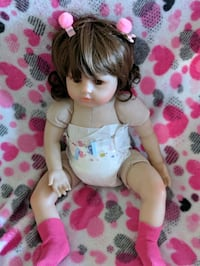 Reborn girl toddler doll c/w several outfits