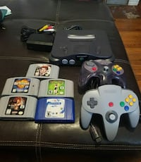 Nintendo 64 console with controllers and game cartridges