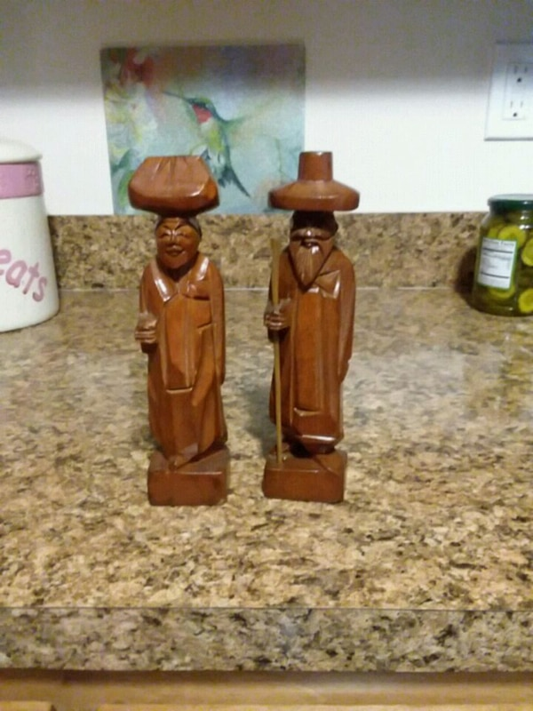 Two hand carved wooden Tiki dolls
