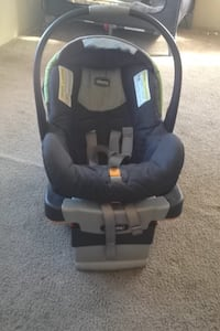 black and gray Chicco infant car seat