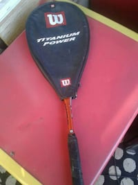 red and black Wilson  badminton racket with cover
