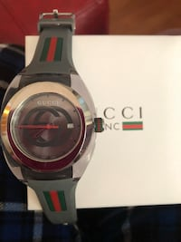 Round silver and red analog watch with black strap