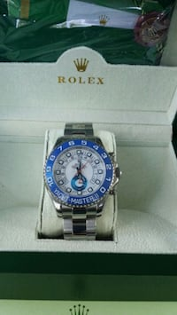 round blue Rolex analog watch with silver link bracelet Tampa
