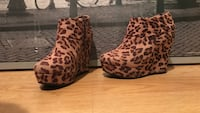 Pair of brown leopard skin print wedges size 7