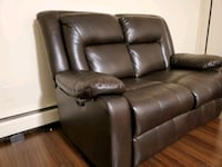 Leather loveseat power reclining