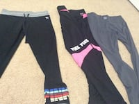 three gray, black and pink leggings