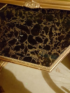 black and brown marble top wooden framed table